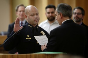 Eddie Garcia is sworn in as the permanent chief of police by city manager Norberto Duenas during a city council meeting Tuesday afternoon, March 1, 2016, in San Jose, Calif. (Karl Mondon/Bay Area News Group)